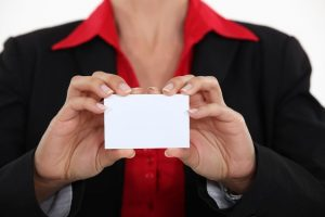 15794001 - woman holding a business card